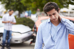 Teenage Driver Suffering Whiplash Injury Traffic Accident Royalty Free Stock Photography