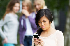 Teenage Girl Being Bullied By Text Message On Mobile Phone Royalty Free Stock Image