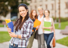 Teenage girl with folders and mates on the back Stock Photography