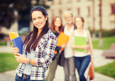 Teenage girl with folders and mates on the back Stock Photo