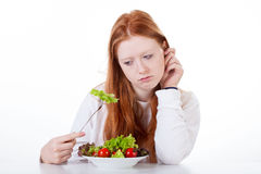 Teenage girl with no appetite Stock Image