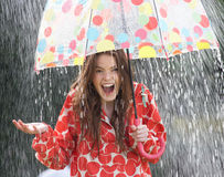 Teenage Girl Sheltering From Rain Beneath Umbrella Stock Images