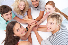 Teens relaxing on the floor in a circle Royalty Free Stock Photo