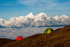 Tents in front of a snow mountain Royalty Free Stock Image