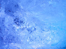 Texture of ice  with blue back light. Royalty Free Stock Photos