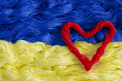 Texture thread with the image of the flag of Ukraine and heart Royalty Free Stock Photos
