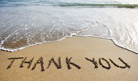 Thank you word drawn on the beach sand Royalty Free Stock Photography