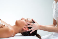 Therapist doing healing osteopathic treatment on woman. Royalty Free Stock Photos