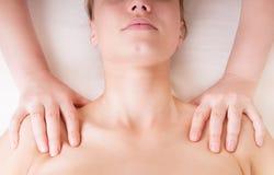 Therapist doing shoulders massage Stock Image