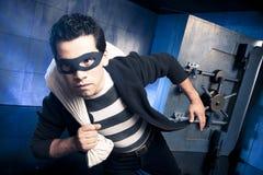 Thief running away with money Stock Photos