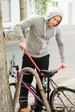 Thief trying to break the bicycle lock Stock Photography