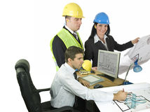 Three architects at office Stock Photos