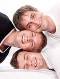 Three happy friends having fun on a white Stock Photo