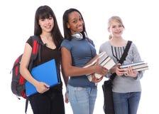 Three teenage ethnic student girls in education Stock Photography