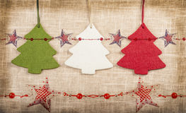Three vintage christmas trees background with stars Stock Image