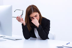 Tired businesswoman rubbing her eyes Royalty Free Stock Photo