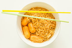 Tom yum goong flavour Instant  noodle with sausage Royalty Free Stock Photography