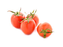 Tomato with stem on white Royalty Free Stock Image