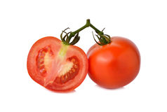 Tomatoes with stem on white Royalty Free Stock Photos