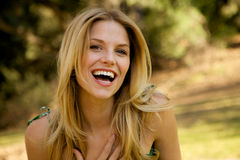 Toothy Smile Blonde Girl Stock Photo