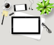 Top view of office desk with paper, stationery and tablet computer Royalty Free Stock Photo