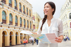 Tourist holding travel map in Macau Royalty Free Stock Images