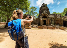 Tourist photographing the ancient gopura in Angkor, Cambodia Royalty Free Stock Photo