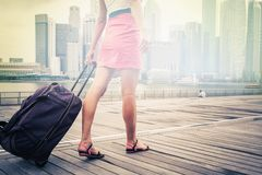 Tourist or woman adventure with luggage in Singapore Royalty Free Stock Photo