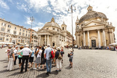 Tourists group with tour guide in Rome, Italy. Piazza del Popolo. Traveling Royalty Free Stock Photo