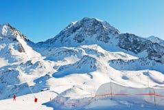 Tracks on mountains slopes in Paradiski region Stock Photos