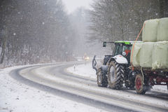 Haulage of livestock feed on winter road Royalty Free Stock Image