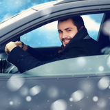 Transportation, winter and people concept - happy man driver Stock Images