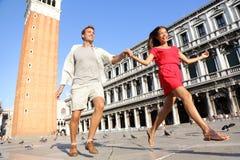Travel couple in love having playful fun in Venice Stock Photos