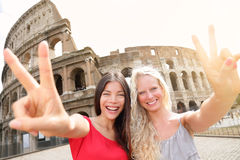Travel tourist girl friends by Colosseum, Rome Royalty Free Stock Photography