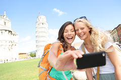 Travel tourists friends taking photo in Pisa Royalty Free Stock Images