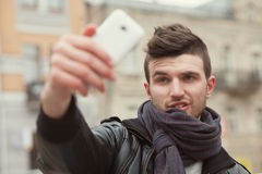 Trendy guy taking a selfie Royalty Free Stock Images