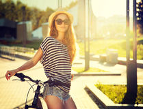 Trendy Hipster Girl with Bike in the City Royalty Free Stock Image