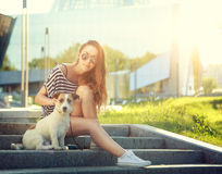 Trendy Hipster Girl with her Dog in the City Stock Image