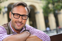 Trendy man with eyeglasses looking at camera Royalty Free Stock Image