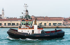 Tug boat in front of the old port in Venice Royalty Free Stock Photography