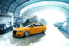 Tuned Audi S4 with yellow bike Royalty Free Stock Photography