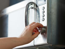 Turn on microwave oven Royalty Free Stock Photos
