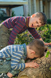 Twin brothers explore the hole Royalty Free Stock Photography
