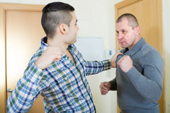 Two adult males having fight Royalty Free Stock Images