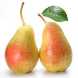 Two appetizing pears with a leaf. Royalty Free Stock Images