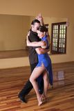Two ballroom dancers practicing in their studio Stock Photography