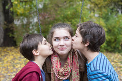 Two boys kissing a teenage girl Stock Photo