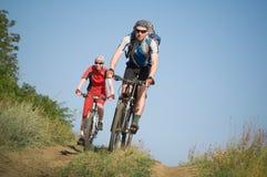 Two cyclists biking Royalty Free Stock Image