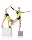 Two high skill acrobats stand on cube Royalty Free Stock Photography