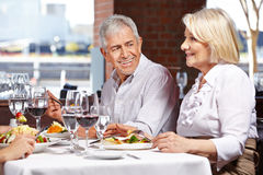 Two seniors eating out Stock Photo